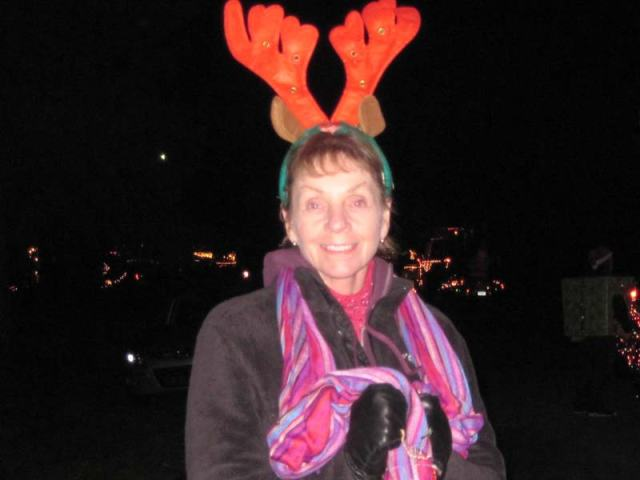 Bonney all decked out in her LED flashing light antlers. All four of us on the sleigh float wore these silly things, while just about everybody on the parade route wanted to know where Rudolph was. We told them he jumped off...
