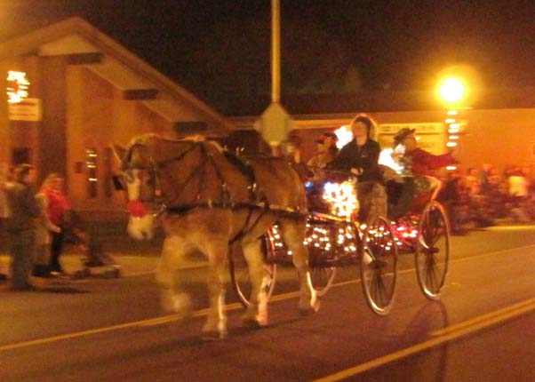 Wendy drives and Dale brings Santa and Mrs. Claus along for the parade finale.