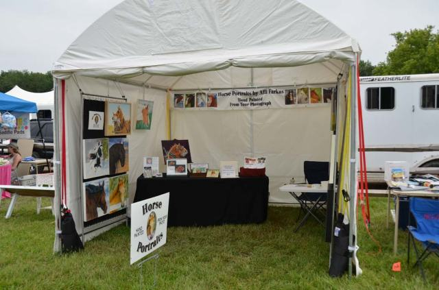 My booth, which survived the storm. Notice the nice little mud path back to the table!
