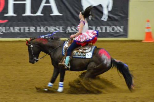 """One of the """"young-uns"""" all dressed up for her freestyle ride in a red, white and blue theme."""