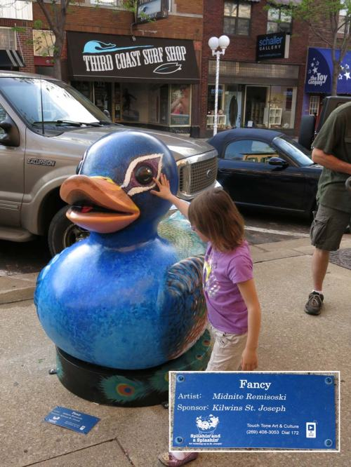 """Midnite's painted duck, which she named """"Fancy"""". The plaque gives her official credit for this complex paint job."""