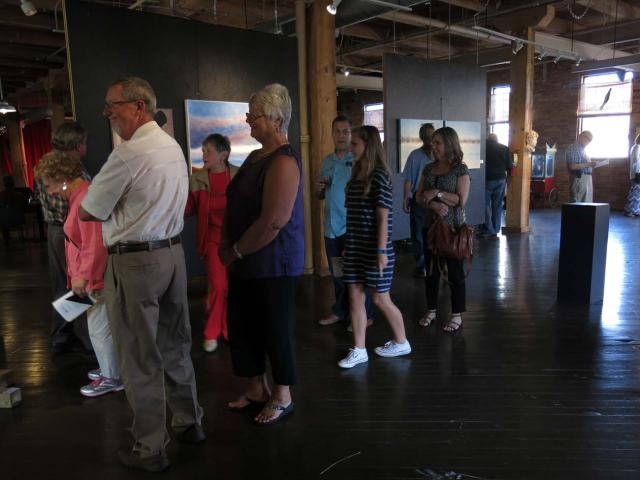 Crowd circulating through the gallery, near my painting.