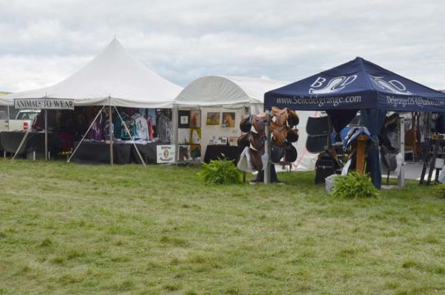 "My booth, ""nestled"" between a very high-end saddler and a super popular retailer of custom printed Kerrits equestrian clothes."