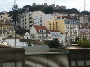 Buildings just climb up the hills here. That's an old castle on top.