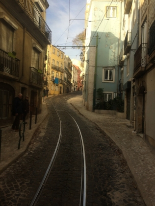 Even narrower hilly street. Only room for one-way tram on this one.