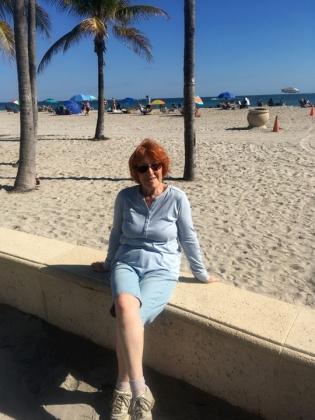 Not-so-suntan Alli on the beach